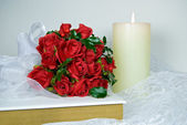 Red Wedding roses on Holy Bible — Стоковое фото