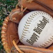 Birthday baseball in glove — Stock Photo