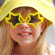 Stock Photo: Little girl in star sunglasses
