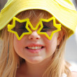 Little girl in star sunglasses — Stock Photo