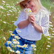 Girl with wild daisy bouquet - Stock Photo