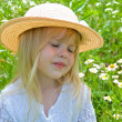 Shy child in daisy field — Stock Photo #11152712