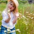 Silly child with daisies - Stock Photo