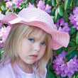 Girl in pink hat — Stock Photo