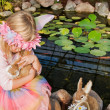 Fairy child hugging a bunny — Stock Photo