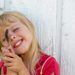 Child with bird feather — Stock Photo #11152807