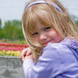 Girl on a fence — Stock Photo #11152813