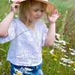 Child in daisies — Stock Photo #11152822