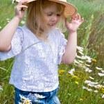 Child in daisies — Stock Photo #11152822