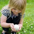 Girl holding a goose egg — Stock Photo #11152842