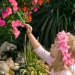 Fairy child painting flowers — Stock Photo