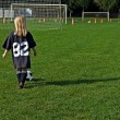 Little girl playing soccer — Stock Photo