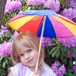 Small child with colorful umbrella — Stock Photo