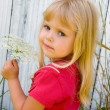 Blond little girl with Queen Anne's lace — Stock Photo