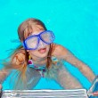 Girl in blue swim goggles — Stock Photo
