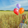 Stock Photo: Girl with balloon bouquet