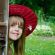 Foto Stock: Young girl wearing summer hat