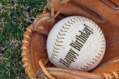 Birthday baseball in glove — Stock Photo