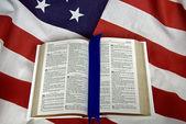 Open Bible on flag — Stock Photo