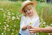 Smiling child giving a bouquet — Stock Photo