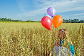 Girl with balloon bouquet — Stock Photo