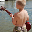 Playing guitar by the bay — Stock Photo #11173694