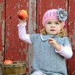 Stock Photo: Child ready to throw apple