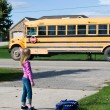 Royalty-Free Stock Photo: Child waving at school bus
