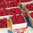 Raspberries at the market — Stock Photo