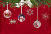 Hanging Holiday ornaments with bow — Stock Photo