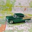 Vintage car on road map — Foto de Stock