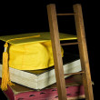 Gold graduation cap with ladder — Stock Photo #11316770
