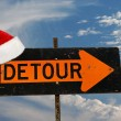 Santa's hat on detour sign — Stock Photo