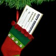 Gift certificate in Christmas stocking — Stock Photo