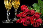 Roses and champagne — Stock Photo