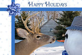 Deer with Christmas snowman — Stock Photo