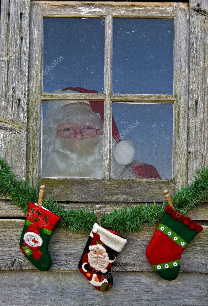 Santa peeking out of a workshop window. — Stock Photo #11345537