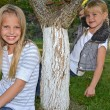 Sisters posing by tree — Stock Photo