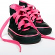 Pink shoelace in sneakers — Stock Photo #11377448