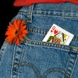 Queen of hearts in pocket — Stock Photo