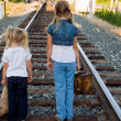 Kids on railroad track — Stock Photo #11379385
