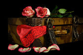 Red lingerie in old suitcase — Stock Photo
