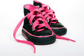 Pink shoelace in sneakers — Stock Photo