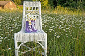 Purple sneakers on chair — Stock Photo