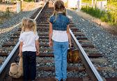 Kids on railroad track — Stock Photo