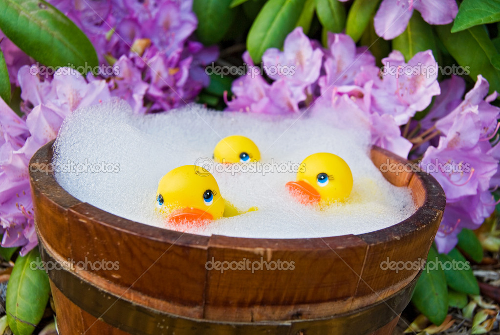 Yellow rubber ducks floating in soapy bubbles. — Stock Photo #11377506
