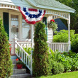 Flag bunting on house — Foto Stock