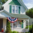 Patriotic bunting on farmhouse — Foto Stock