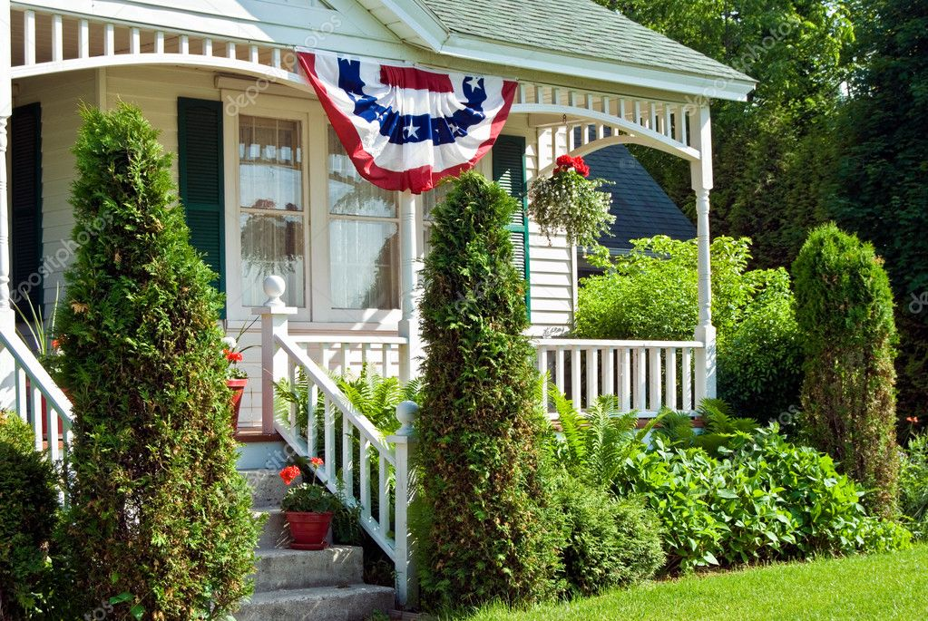 Holiday flag bunting on a farmhouse porch. — Stock Photo #11440330