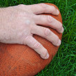 Stock Photo: Man's hand on football